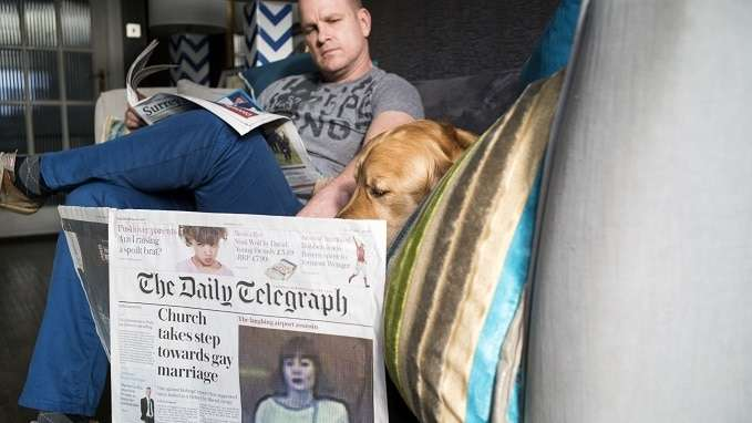 dog-sitter and dog reading papers